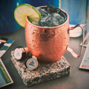 Moscow Mule garnished with a lime wedge. uses best vodka in the world Georgian Bay Vodka