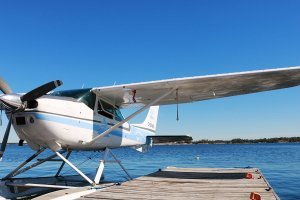 Georgian Bay Spirit Co's float plane sitting at a dock on a sunny day